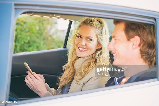 Young Couple in a Ride Share Taxi