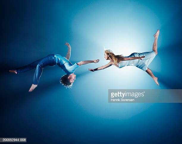 Young couple in air, low angle view