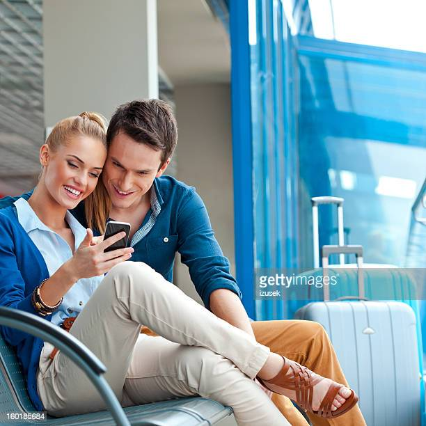 Young couple in an airport lounge