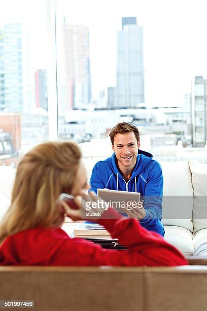 young couple in an apartment - izusek stock pictures, royalty-free photos & images