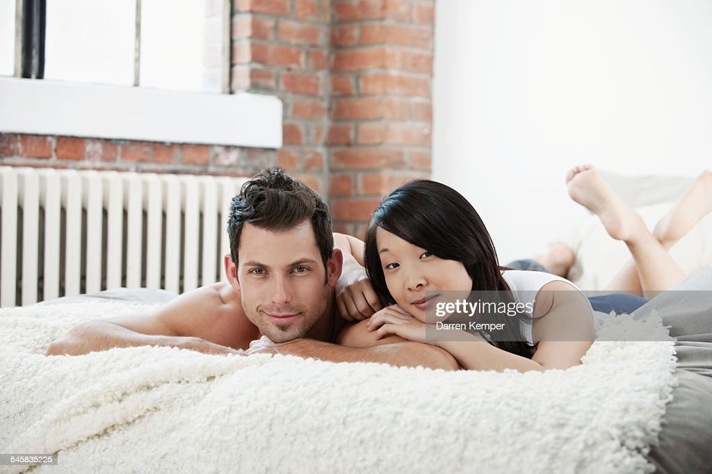 Young couple in bed : Stock Photo