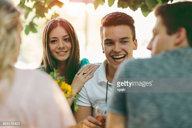 Young Couple In Cafe Outdoors.