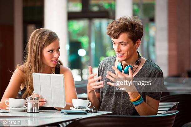 young couple in cafe - izusek stock photos and pictures