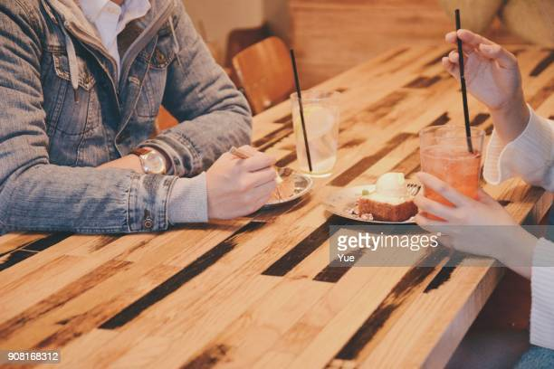 young couple in cafe - heterosexual couple stock pictures, royalty-free photos & images