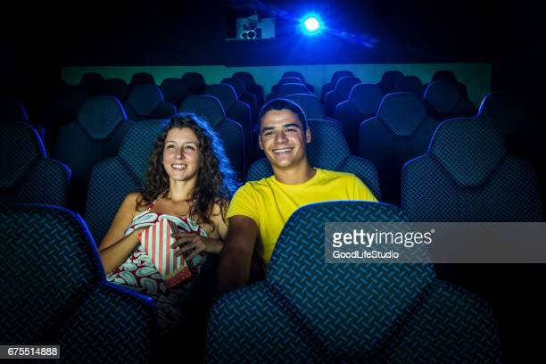 Young couple in cinema