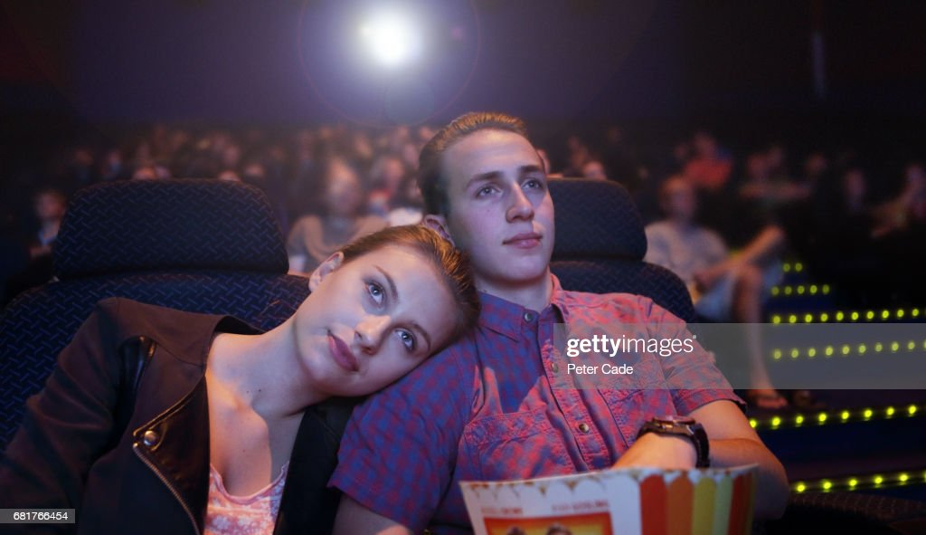 Young couple in cinema : ストックフォト
