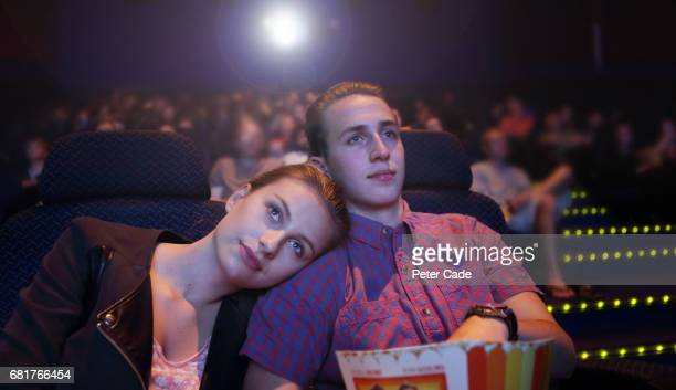 young couple in cinema - dating stock pictures, royalty-free photos & images