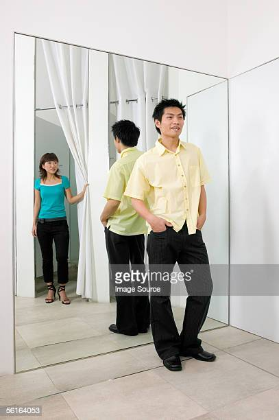 Young couple in clothes store
