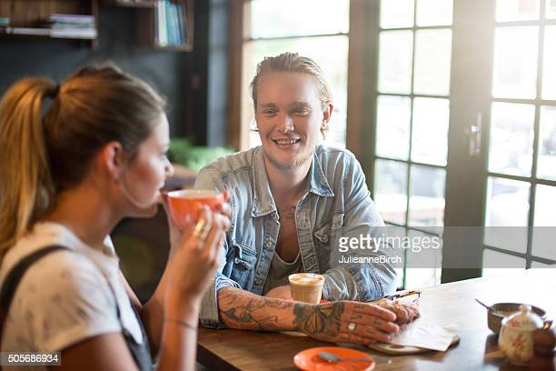 Young couple in coffee bar