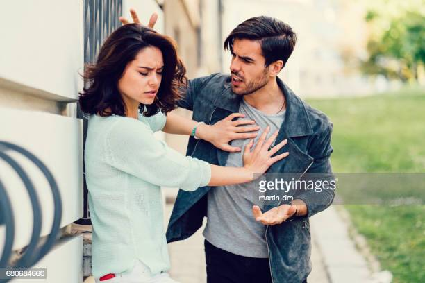 young couple in conflict - heterosexual couple photos stock photos and pictures
