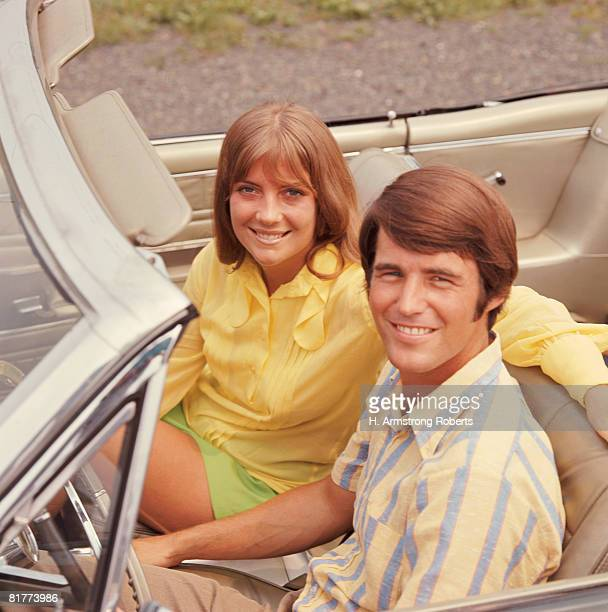 Young couple in convertible car, portrait. (Photo by H. Armstrong Roberts/Retrofile/Getty Images)