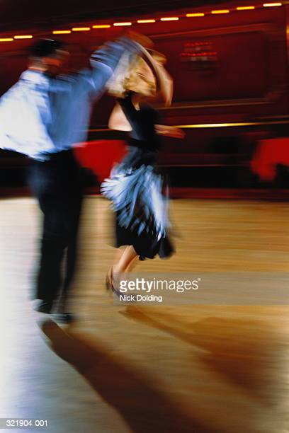 young couple in costume, dancing together, blurred action - rock photos et images de collection