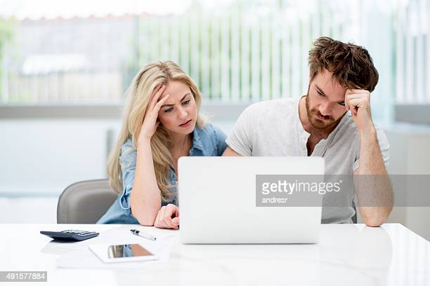 Young couple in financial trouble