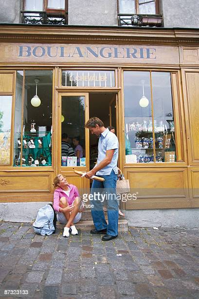 Young couple in front of a shop