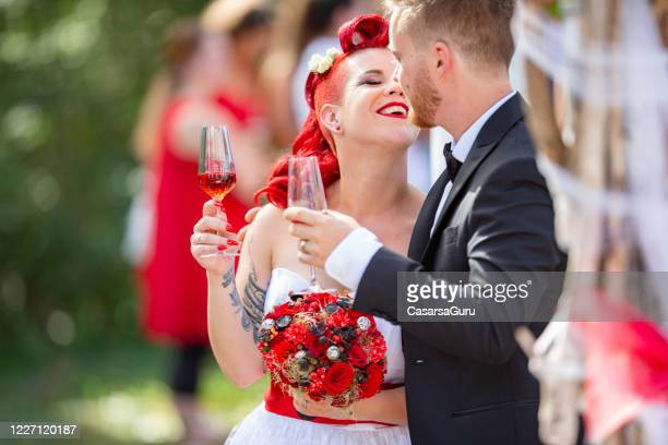 young couple in front of altar just got married looking at each other with love - stock photo - country and western stock pictures, royalty-free photos & images