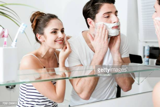 Young couple in front of mirror in the morning