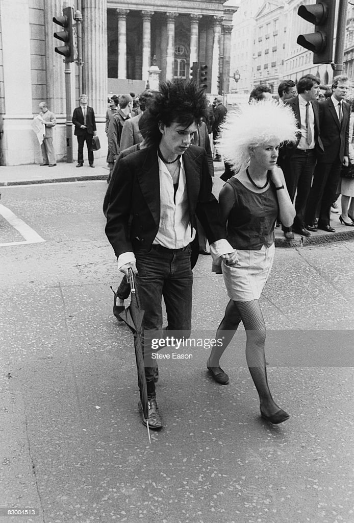 A young couple in gothic punk fashions during a 'Stop The City' anti-capitalist demonstration, London, September 1984.