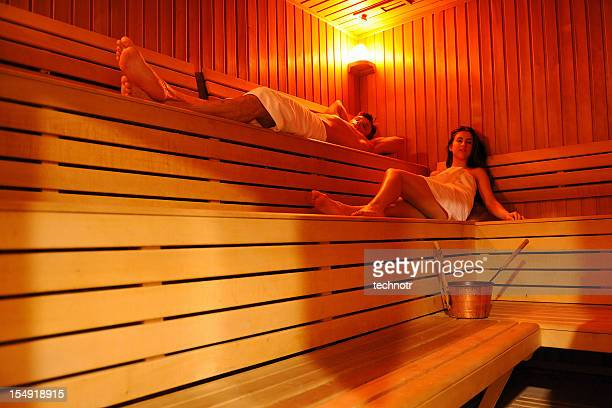 Young couple in infrared sauna
