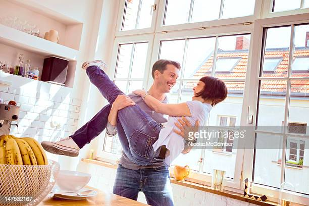 Young couple in kitchen domestic bliss