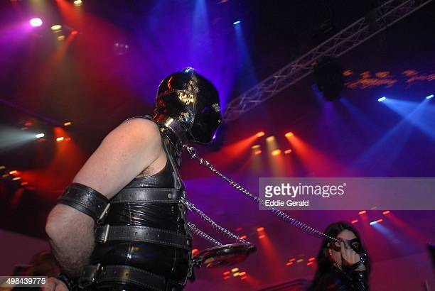 A young couple in leather outfit performing Sado Maso show in a club Tel Aviv Israel