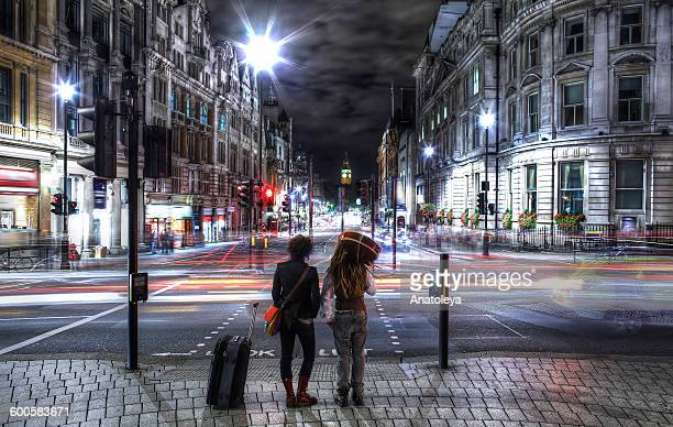 young couple in london at night - anatoleya stock pictures, royalty-free photos & images