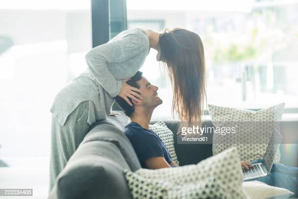 young couple in love at home - massage homme femme photos et images de collection