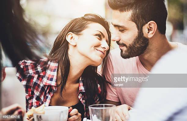 young couple in love at the coffee bar - flirting stock pictures, royalty-free photos & images