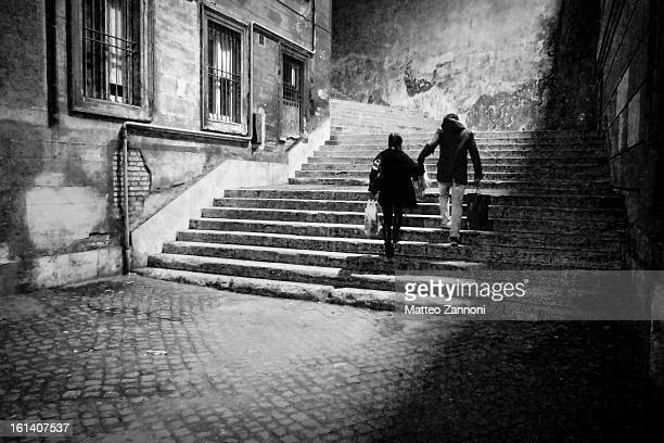 Young couple in love. Dark stairs, a strange premonition. Noir scene. Mystery.
