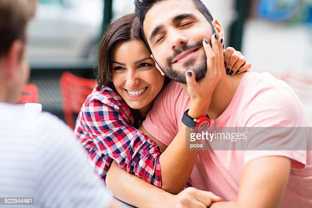 Young couple in love enjoying the company of friends