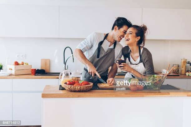 young couple in love in the kitchen - boyfriend stock pictures, royalty-free photos & images