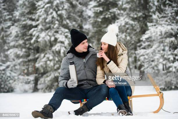 young couple in love. man and woman enjoying romantic date. - woman sitting on man's lap stock pictures, royalty-free photos & images