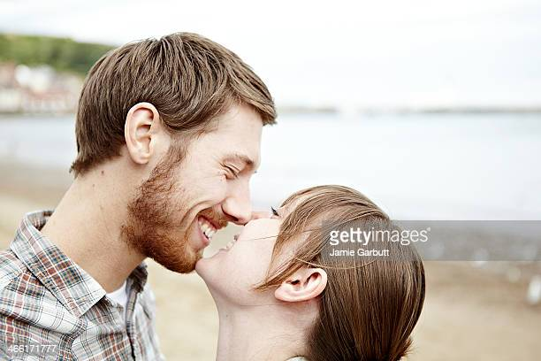 young couple in love sharing a tender moment - heterosexual couple stock pictures, royalty-free photos & images