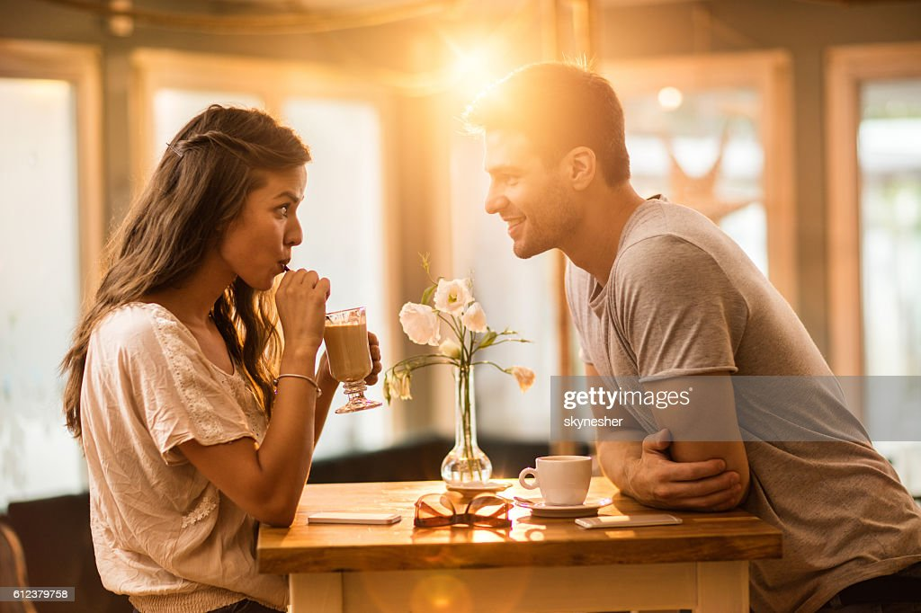 Young couple in love spending time together in a cafe. : Stock Photo