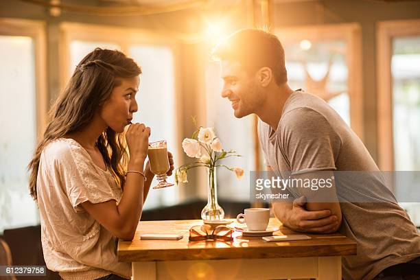 young couple in love spending time together in a cafe. - romance fotografías e imágenes de stock