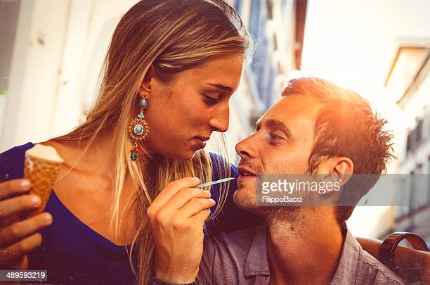 Young couple in love while eating an ice-cream