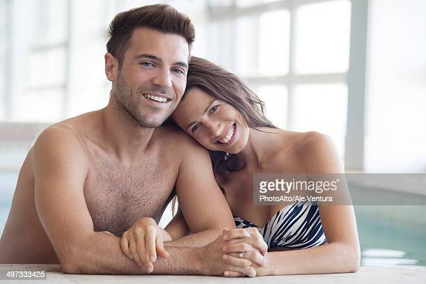 Young couple in pool together, portrait