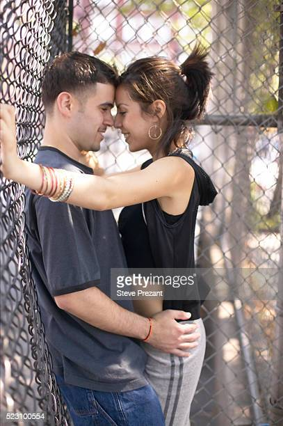 young couple in schoolyard - seduction stock pictures, royalty-free photos & images