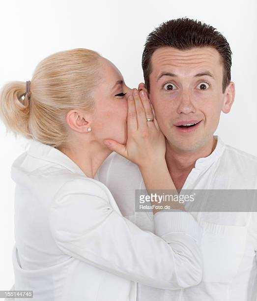 Young couple in secret communication