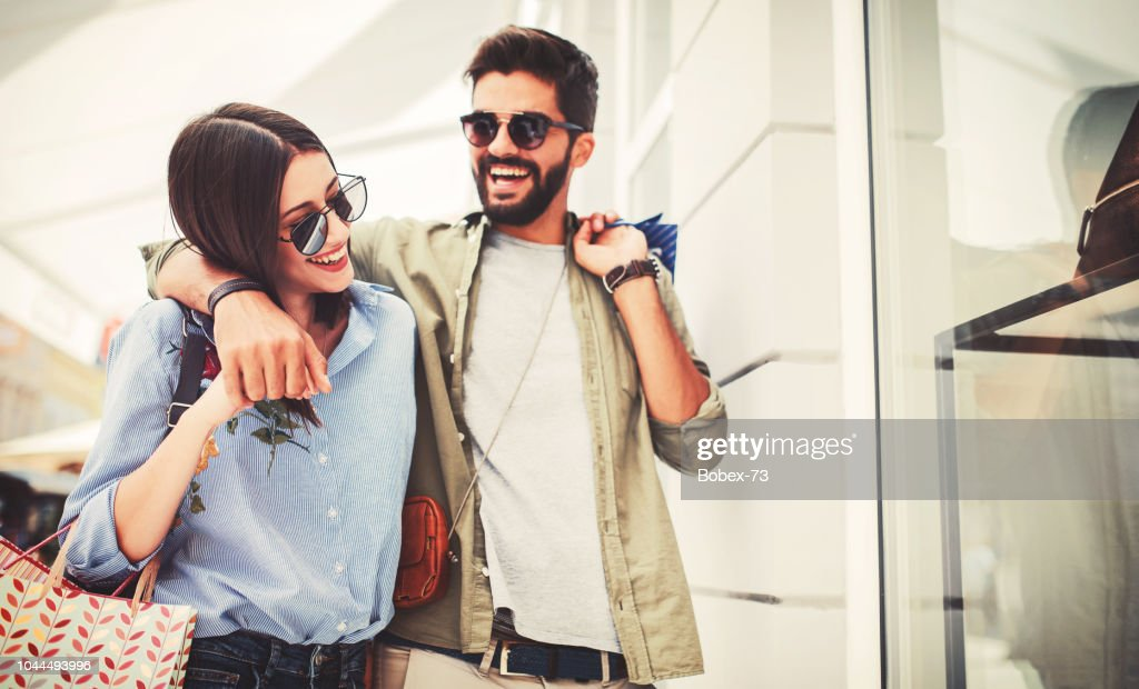 Young couple in shopping. Consumerism, love, dating, lifestyle concept : Stock Photo
