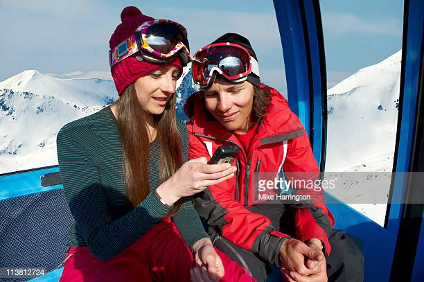 Young Couple In Ski Lift On Bansko Mountains