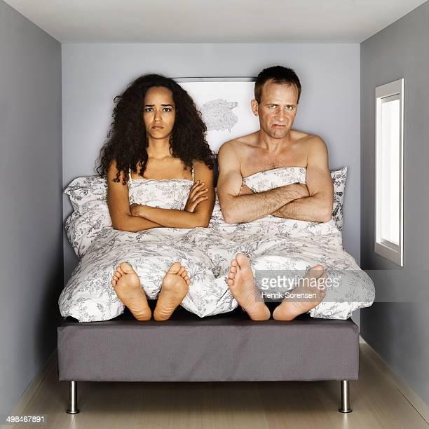 young couple in small bed room