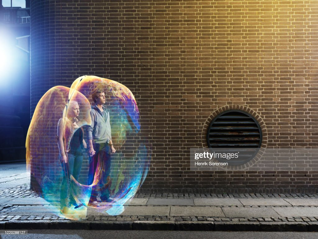 young couple in soapbubbles : Stock Photo