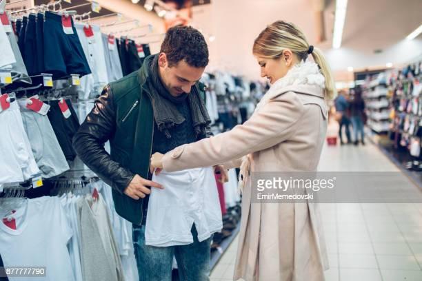 young couple in store buying men's underwear - homem de cueca imagens e fotografias de stock