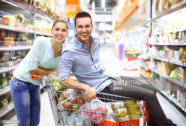Young couple in supermarket.
