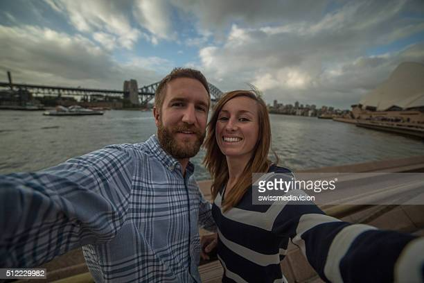 Young couple in Sydney harbour, take a selfie portrait