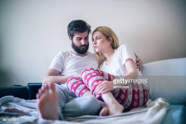 young couple in the bed in the morning - human fertility stock pictures, royalty-free photos & images