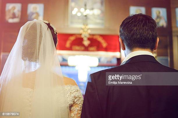 Young couple in the church on their wedding day