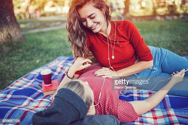 young couple in the city park - lesbian date stock pictures, royalty-free photos & images