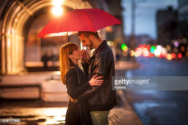 Young couple in the rain