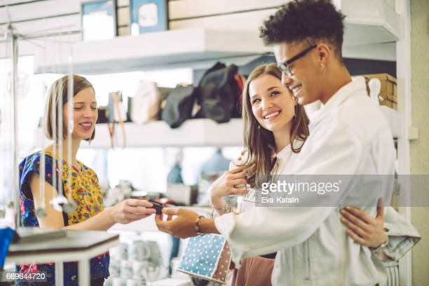 young couple in the shopping mall - gift shop stock pictures, royalty-free photos & images